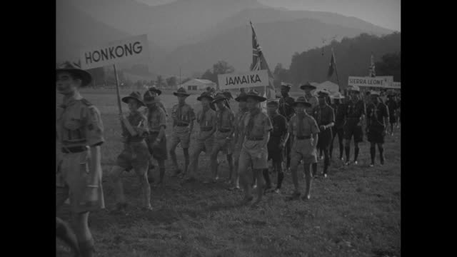 salzburg world scout jamboree / vs parade of boys carrying country signs gibraltar honking jamaica usa / boys dressed as native americans / vs more... - austria flag stock-videos und b-roll-filmmaterial
