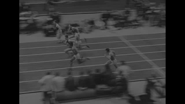 title superimposed on men at starting line on inside track boston mass / hurdlers in 45 yard race finish into padded wall forrest townes wins / ben... - men's track stock videos and b-roll footage
