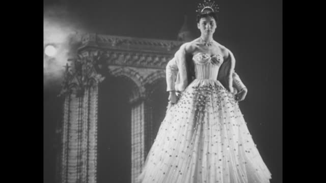title superimposed on model and sculpture paris at night a background for fashions / vs several women in fullskirted strapless gowns are seen over... - 1950 bildbanksvideor och videomaterial från bakom kulisserna