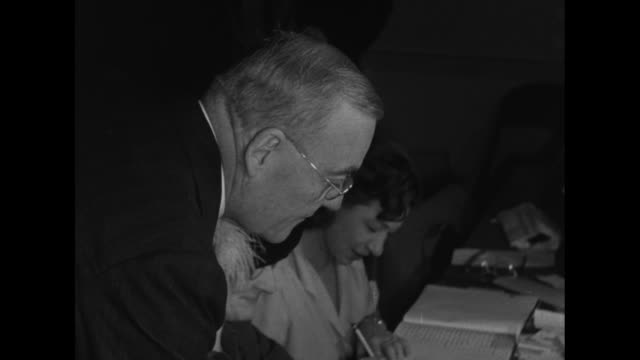 Title superimposed on New York City street 'Democrats sweep NY elections Truman happy' / sign on glass window 'Barber Shop 57 Board of Election...
