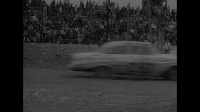 title superimposed on racetrack stock cars sear sands at daytona beach / stock cars throw sand up as they go into a curve / vs cars passing... - 1956 bildbanksvideor och videomaterial från bakom kulisserna