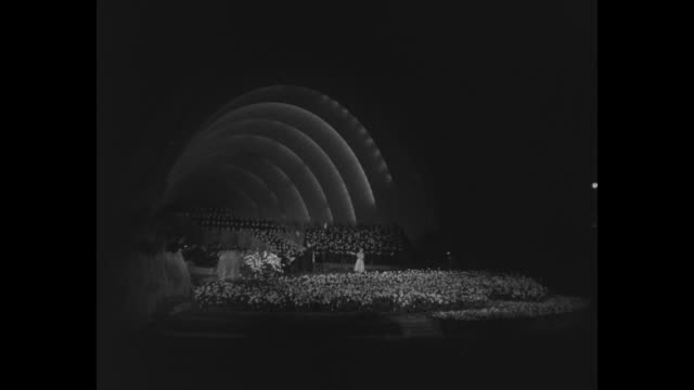 easter 1951 / vs stage of amphitheater at arlington national cemetery / title hollywood / shots of hollywood bowl / trumpeters in white robes / those... - top hat stock videos & royalty-free footage