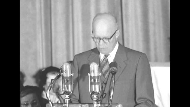 """title superimposed over pres. dwight eisenhower at podium: """"ike warns church women of atom bomb"""" / people applauding on stage with """"united church... - nuclear weapon stock videos & royalty-free footage"""