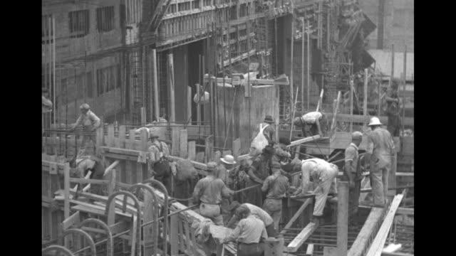 "vídeos de stock, filmes e b-roll de title ""tennessee"" superimposed on tennessee valley authority construction site at the pickwick landing dam hydroelectric facility / vs framework and... - nova negociação"