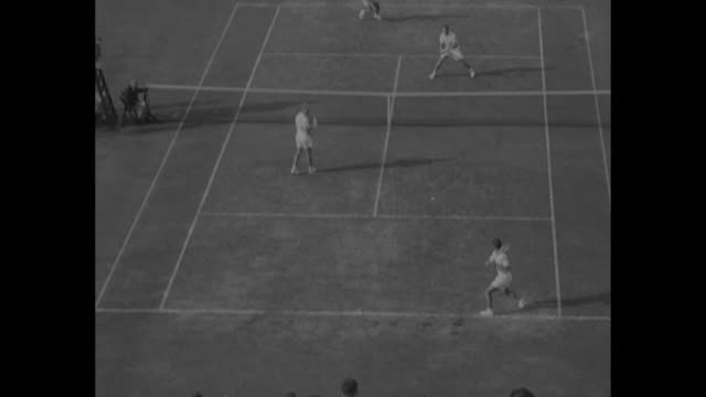 title tennis superimposed over tennis players / big crowd in stands / ongoing doubles match with rex hartwig and lew hoad playing for australia and... - davis cup stock videos & royalty-free footage