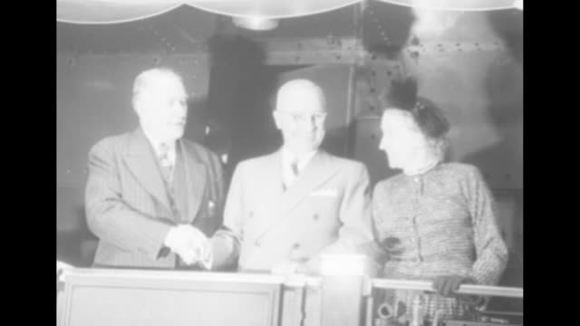 stockvideo's en b-roll-footage met the campaign / pres harry truman walking along in train station in washington dc shakes hands with little girl in crowd / truman stands on back of... - margaret truman