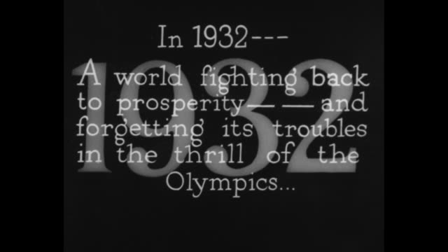 """title """"the highlights of 1932"""" superimposed over movie camera and cameraman turning crank / title card: """"in 1932 - a world fighting back to... - olympische spiele stock-videos und b-roll-filmmaterial"""