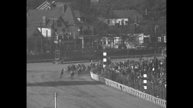 """""""the kentucky derby"""" superimposed on horses in the race / title: """"described by clem mccarthy"""" superimposed on him looking through big lenses or... - fast motion stock videos & royalty-free footage"""