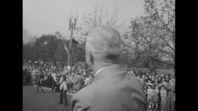 title the winners superimposed over pres harry truman vice pres alben barkley shaking hands / vs motorcade to white house they both sit on back of... - alben w. barkley stock videos and b-roll footage