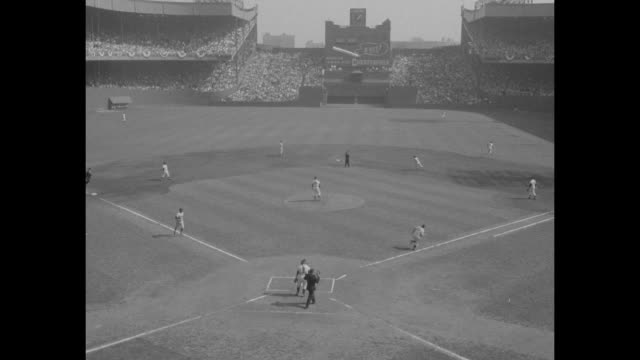 the world series superimposed over polo grounds stadium from stands with bronx skyline in background / vs new york giants manager leo durocher and... - sun visor stock videos and b-roll footage