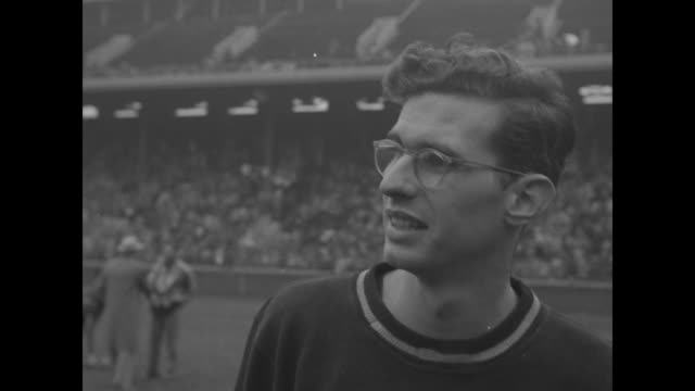 Track Penn Relays superposed over runners on track / SLOW MOTION Dick Baster runs pole vaults / crowd one man in letter sweater / Dick Philips and...