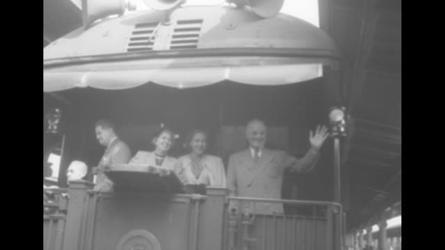 truman ends tour / title mr truman superimposed over young girl pinning something on pres harry truman's lapel as he bends over / 10/1/1948 ws truman... - harry truman stock videos and b-roll footage