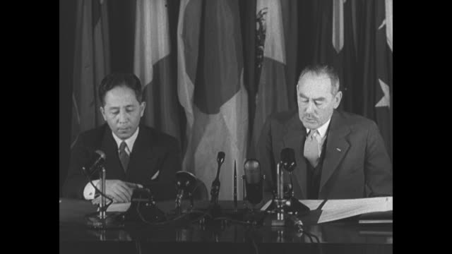 us hails japan as independent nation / japan's charge d'affaires ryuji takeuchi and us secretary of state dean acheson sign peace treaty camera... - matthew b. ridgway stock-videos und b-roll-filmmaterial