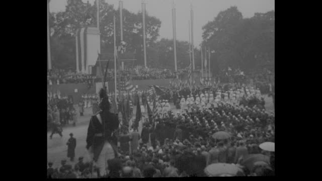 "vídeos de stock, filmes e b-roll de ""versailles"" superimposed over crowds and soldiers and color guard near new memorial to franco-american cooperation in world war i / us color guard... - new age"