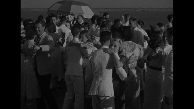 virginia superimposed over front view of battleship uss new york / us naval academy midshipmen climbing up steps to ship / midshipmen walk across... - 士官候補生点の映像素材/bロール