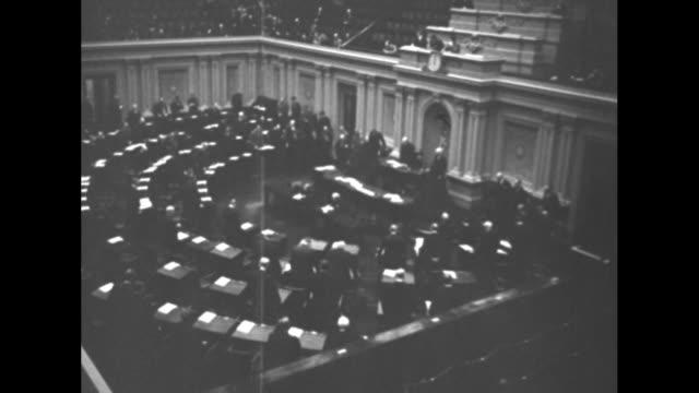 vídeos y material grabado en eventos de stock de title washington dc superimposed over overhead shot of us senators seated in senate chamber / overhead shot of vice president john nance garner... - senador