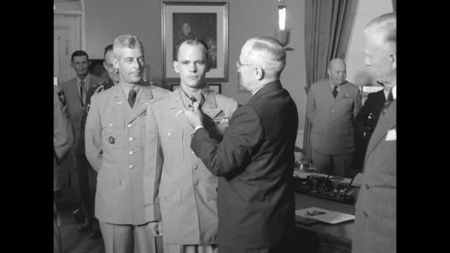washington dc superimposed over three soldiers standing in oval office of the white house / president harry truman places medal of honor on first... - sergeant stock videos & royalty-free footage