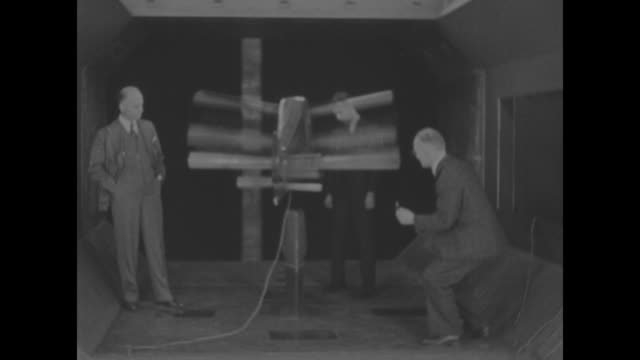 washington superimposed over prof frederick k kirsten and colleagues examining new model airplane with rotary blades kirsten's invention the... - 発明家点の映像素材/bロール