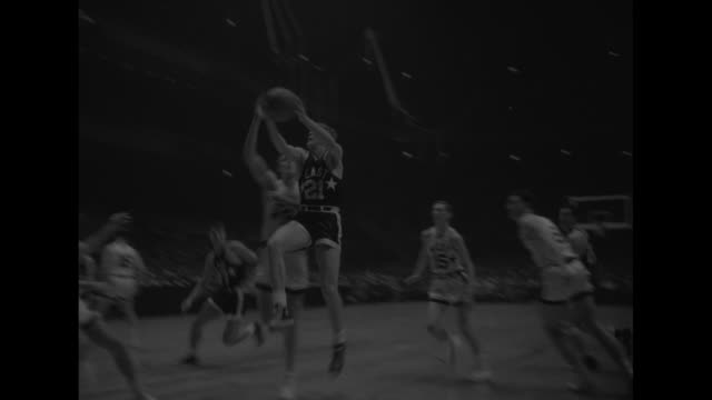 west vs east allstar basketball superimposed over ws jump ball to begin basketball game in madison square garden / various action shots of game in... - jump ball stock videos and b-roll footage