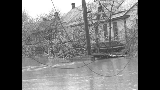 williamsport md superimposed over flooded streets in residential area / pov from boat of flooded residential area and wires hanging down / ms house... - civilian conservation corps stock-videos und b-roll-filmmaterial