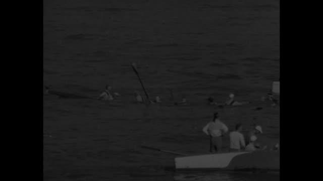 vídeos y material grabado en eventos de stock de wisconsin crew wins at marietta superimposed on shell being piloted / 49th annual intercollegiate rowing associations varsity race motor boats on... - río ohio
