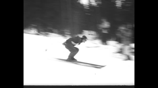 """""""women's downhill skiing"""" superimposed over skier starting downhill run / skier starts downhill run / smiling woman watching race / several shots of... - traditionally austrian stock videos & royalty-free footage"""