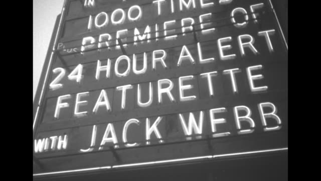 title world premiere airmen star in '24 hour alert' superimposed over airmen arriving at michigan theatre / ws marquee in lights sign premiere of 24... - 商業車点の映像素材/bロール