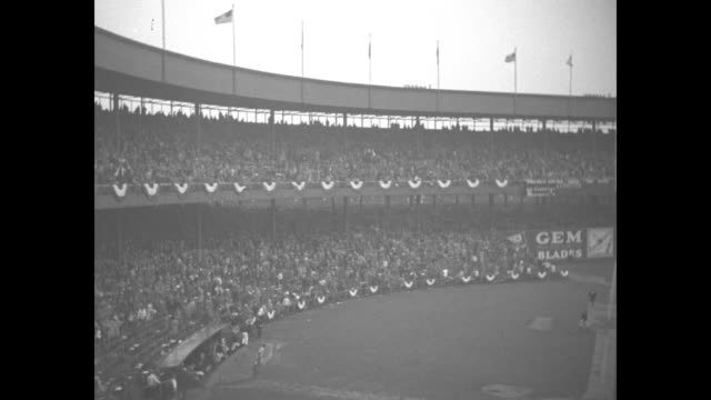 World Series superimposed over action on field / Game One crowd in stands cheering / NY GiantsÕ team stands on edge of dugout in Polo Grounds before...