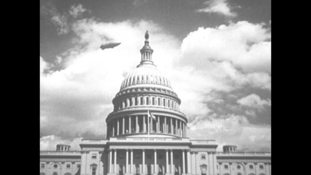 """social security explained"" on card and superimposed on capitol dome / dome with dirigible flying overhead / fade to page of the social security act... - 社会保障点の映像素材/bロール"
