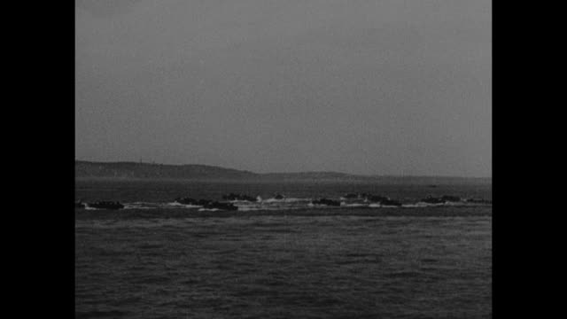 'Combined operations Dieppe the film record of the daylight assault on Nazi occupied Europe' / small flotilla of boats / 'LCP 158' craft moving past...