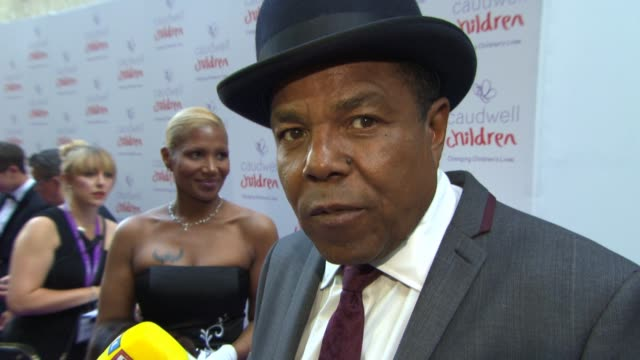 tito jackson on the importance of supporting charities, on lionel richie at the caudwell children butterfly ball at the grosvenor house hotel on june... - ライオネル・リッチー点の映像素材/bロール