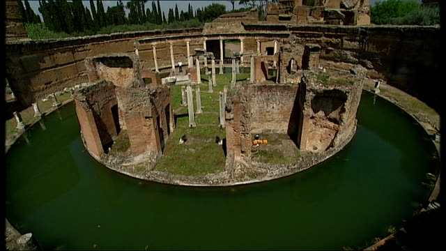 hadrian's villa: ext reporter to camera good general views of ruins of villa and its grounds including carp in fishpond neil macgregor interview sot - neil macgregor stock videos & royalty-free footage