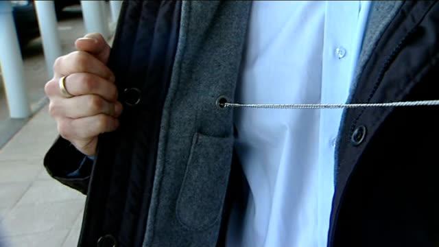vídeos de stock e filmes b-roll de farnborough tkmaxx store knife attached to jacket held by reporter - farnborough hampshire