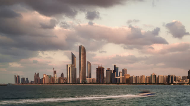 tl/zi day to night zoom in time lapse of the abu dhabi skyline, and financial district, with the arabian sea in foreground - martin luther: his life and time stock videos & royalty-free footage