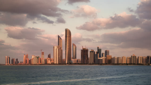 tl/zo day to night zoom out time lapse of the abu dhabi skyline, and financial district, with the arabian sea in foreground - martin luther: his life and time stock videos & royalty-free footage