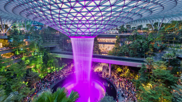 tl/pu/zo the jewel, changi airport, entertainment and retail complex, with the world's tallest waterfall - monorail stock videos and b-roll footage