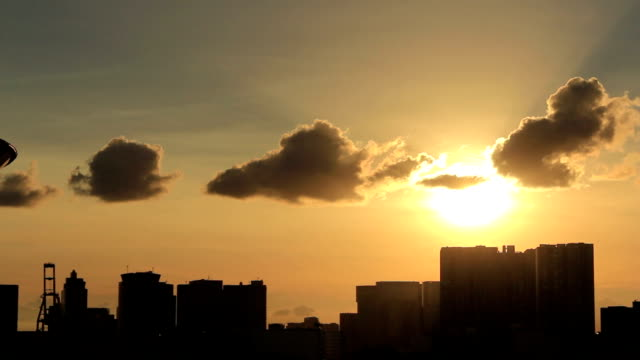 tl,sunset silhouette over buildings and water. tokyo, japan - sunset stock videos & royalty-free footage