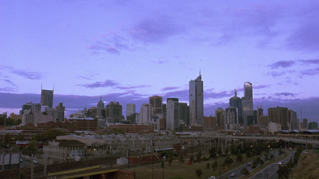 wide angle of melbourne city skyline.  view includes bourke place, rialto towers and melbourne central. downtowns, skylines, skyscrapers, high rises, buildings. matching dx/nx 3012-009 to 3012-013. - 2007 stock videos & royalty-free footage