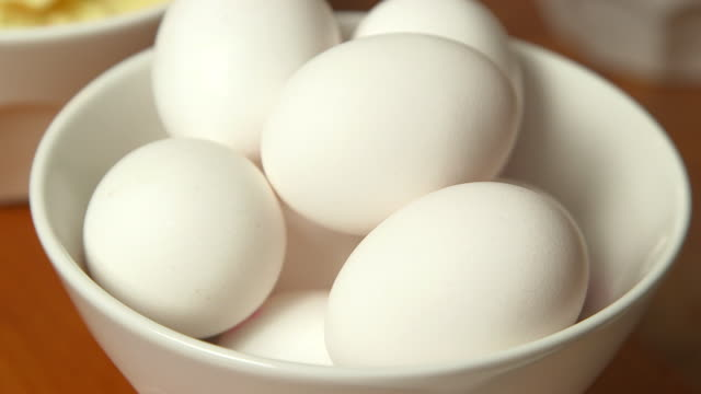 pan to bowl of eggs - gatineau stock videos & royalty-free footage