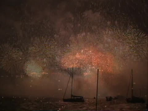 to celebrate the 75th anniversary night shots and great nats of fireworks fireworks exploding over the water wide shot of the bridge with fireworks... - 75th anniversary stock videos & royalty-free footage