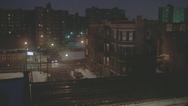 h-d to chicago street with snow, police car around corner under el train - chicago 'l' stock videos & royalty-free footage