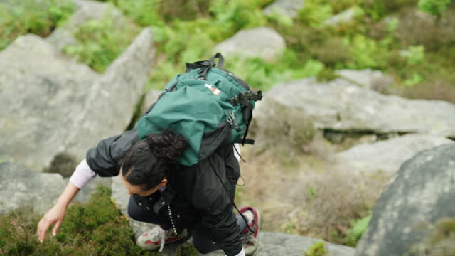 to conquer it, you must climb it - boulder rock stock videos & royalty-free footage