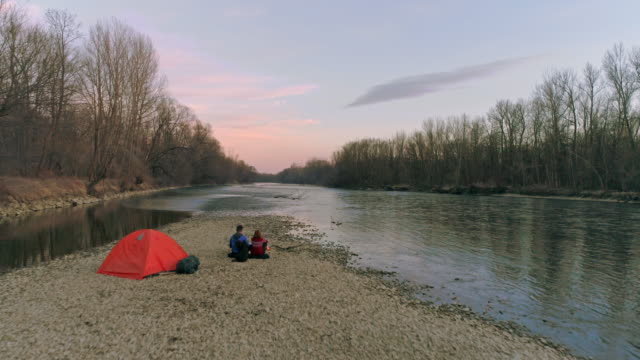 ms to ws couple camping along tranquil autumn mur river,slovenia - viewpoint stock videos & royalty-free footage