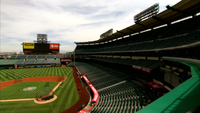 to empty angel stadium ballpark, empty baseball field & seats. ca, home to los angeles angels of anaheim, major league baseball, mlb, american league - angel stadium stock videos & royalty-free footage