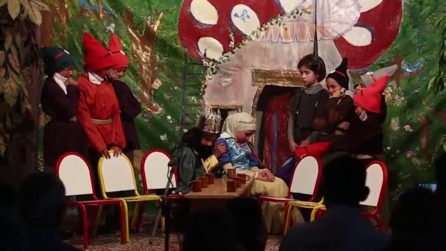 to escape the nightmare of life in their besieged hometown near syria's capital 13 young girls sought refuge in a fairytale performance of snow white... - hometown bildbanksvideor och videomaterial från bakom kulisserna
