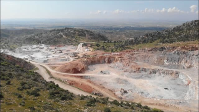 to feed the concrete demands of hotels tourist residences and roads under construction in north cyprus quarries are eating away at the mountains... - north stock videos & royalty-free footage
