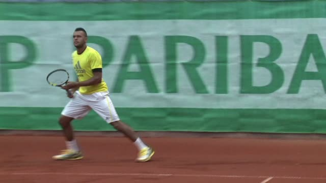 vídeos y material grabado en eventos de stock de to fix spelling of nadals first name french tennis star jo wilfied tsonga comments on his chances at the french open which starts on sunday. clean :... - ortografía