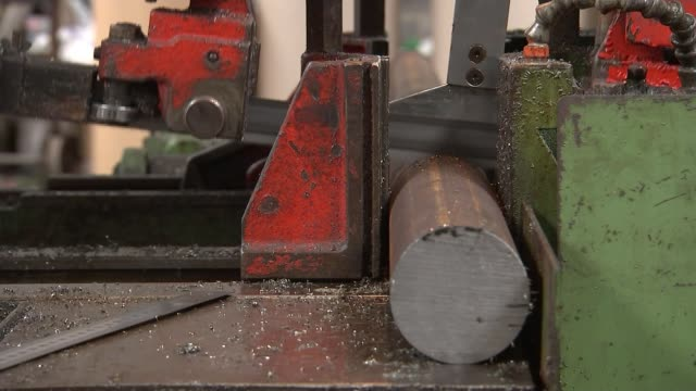 us to impose tariffs on steel and aluminium imports international reaction england yorkshire int duncan ellis operating machine close shots of... - tariff stock videos & royalty-free footage