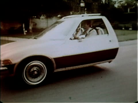 To introduce the Pacer station wagon this commercial shows the front and rear halves of a Pacer wagon merging while driving on a suburban street 1977...