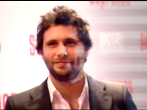 cu zo to ws jeremy sisto standing on red carpet with handler julianna margulies in bg posing for pictures for eager paparazzi - julianna margulies stock videos and b-roll footage